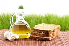 Olive oil,  bread, garlic Stock Photos