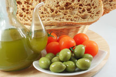 Olive oil, bread, olives, tomatoes Stock Photo