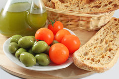 Olive oil, bread, olives, tomatoes Stock Image