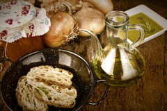Olive oil, bread, onions and canned tomatoes Stock Photography