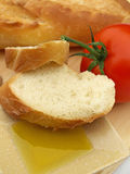 Olive oil bread and tomato Royalty Free Stock Photos