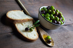 Olive oil and bread on wood Royalty Free Stock Photography