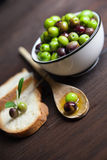 Olive oil and bread on wood Stock Images