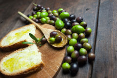 Olive oil and bread on wood Stock Photos