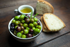 Olive oil and bread on wood Stock Photo