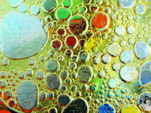 Olive oil bubbles in water close up Stock Images