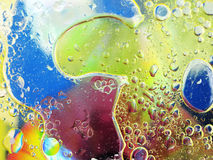Olive oil bubbles in water close up Stock Photo