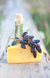 Olive oil, cheese and grapes Royalty Free Stock Photos