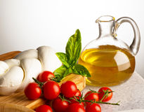 Olive oil with cheese and tomatoes Royalty Free Stock Photography
