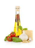 Olive oil, cherry tomatoes, basil, garlic and parmesan Stock Photos