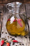 Olive oil with chili peppers Royalty Free Stock Photos