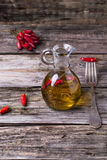 Olive oil with chili peppers Stock Photos