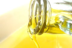 Olive oil close up view on bottle Stock Photo