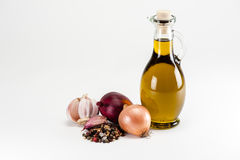 Olive oil with cooking ingredients Royalty Free Stock Photography