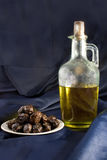 Olive oil and dark olives Stock Photo