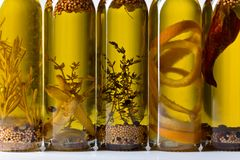 Olive oil with spices and herbs. Royalty Free Stock Photography
