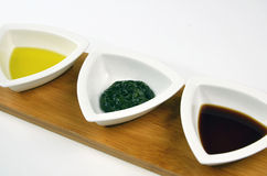 Olive Oil, Dill And Malt For Dipping Or Basting. Trio of sauces in white tasting dishes Royalty Free Stock Image