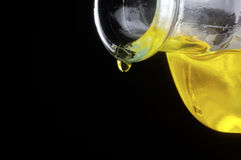 Olive oil drop from a bottle Royalty Free Stock Images