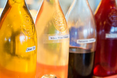 Olive Oil e três vinagres Fotografia de Stock Royalty Free