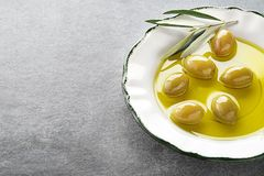 Olive oil with olives and branch royalty free stock photo