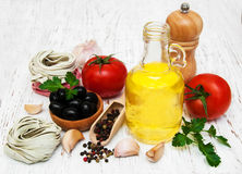 Olive oil,  fettuccine nest, garlic and tomatoes Stock Images
