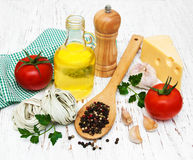 Olive oil,  fettuccine nest, garlic and tomatoes Stock Photo