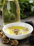 Olive oil flavored with black truffle Stock Images