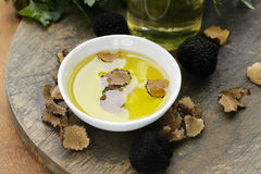 Olive oil flavored with black truffle Stock Photos