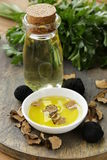 Olive oil flavored with black truffle Royalty Free Stock Photography