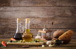 Olive oil flavored with spices Stock Photos