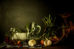 Olive oil and food ingredients still life Stock Image