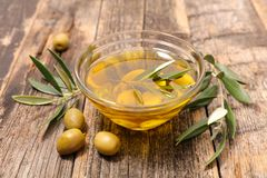Olive oil. Fresh olive and olive oil royalty free stock photos