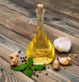 Olive oil with fresh basil and garlic Stock Photos