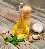 Olive oil with fresh basil and garlic Stock Images