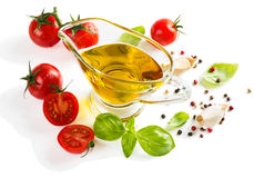 Olive oil with fresh basil leaves and tomatoes Royalty Free Stock Photos