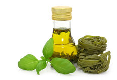 Olive oil, fresh basil and pasta tagliatelle Royalty Free Stock Photography