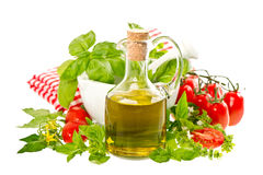 Olive oil with fresh basil and tomatoes. food background Royalty Free Stock Photography