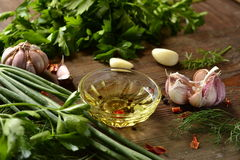 Olive oil, fresh herbs and spices Royalty Free Stock Image