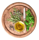 Olive oil with fresh herbs thyme, basil and rosemary Stock Image
