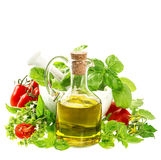 Olive oil with fresh mediterranean herbs and tomatoes Stock Photo