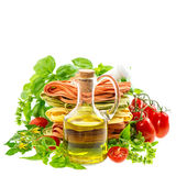 Olive oil with fresh mediterranean pasta, herbs and tomatoes Stock Photography