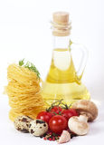 Olive oil with fresh vegetable Stock Photos