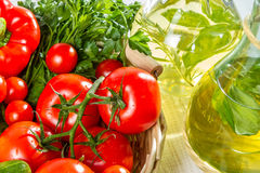 Olive oil and fresh vegetables stock photo