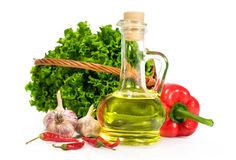 Olive oil with fresh vegetables Stock Photography