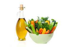 Olive oil and fresh vegetables Stock Images