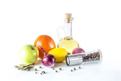 Olive oil, fruits, vegetables and spices on a white background Royalty Free Stock Image
