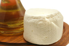 Olive oil and full goat cheese Royalty Free Stock Photography