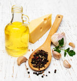Olive oil, garlic and cheese Stock Image
