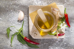 Olive oil, garlic and chili Stock Photos