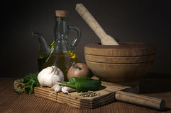 Olive oil with garlic and onions. On wooden board Stock Photo